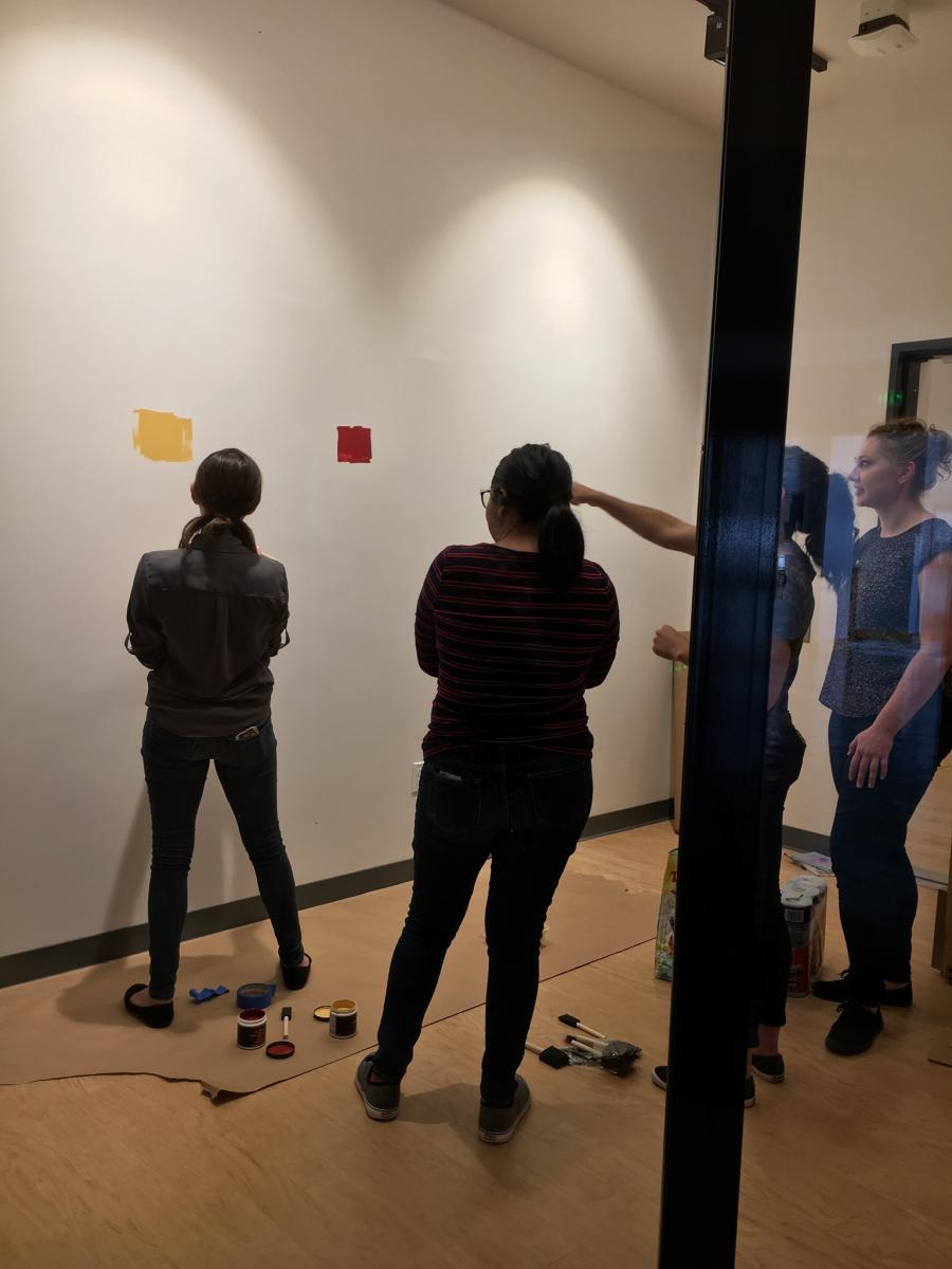 Students working on museum gallery wall